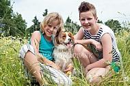 Kooiker met twee kinderen